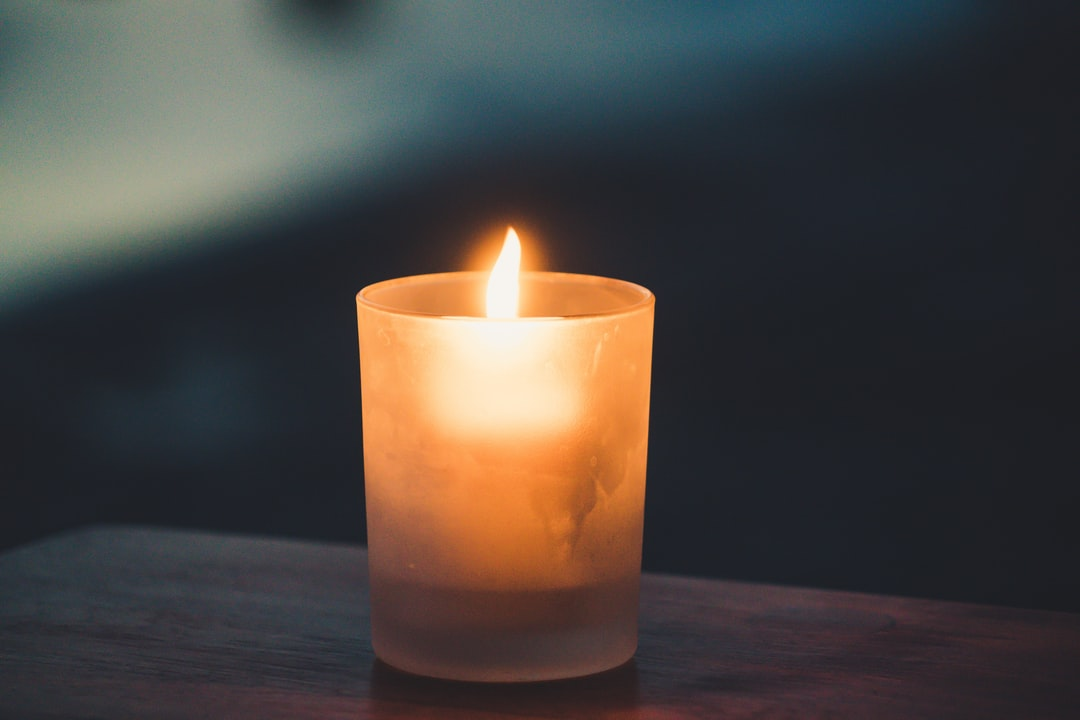 A candle on a table
